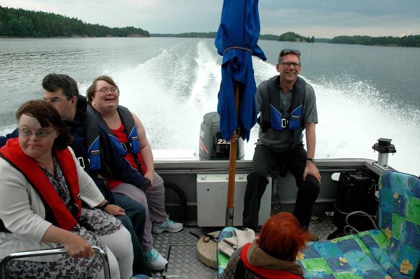 onboard photo of passengers in tour boat speeding across the archipelago